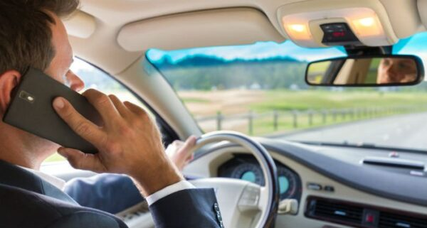 Is it illegal to talk on your cell phone while driving in North Carolina?