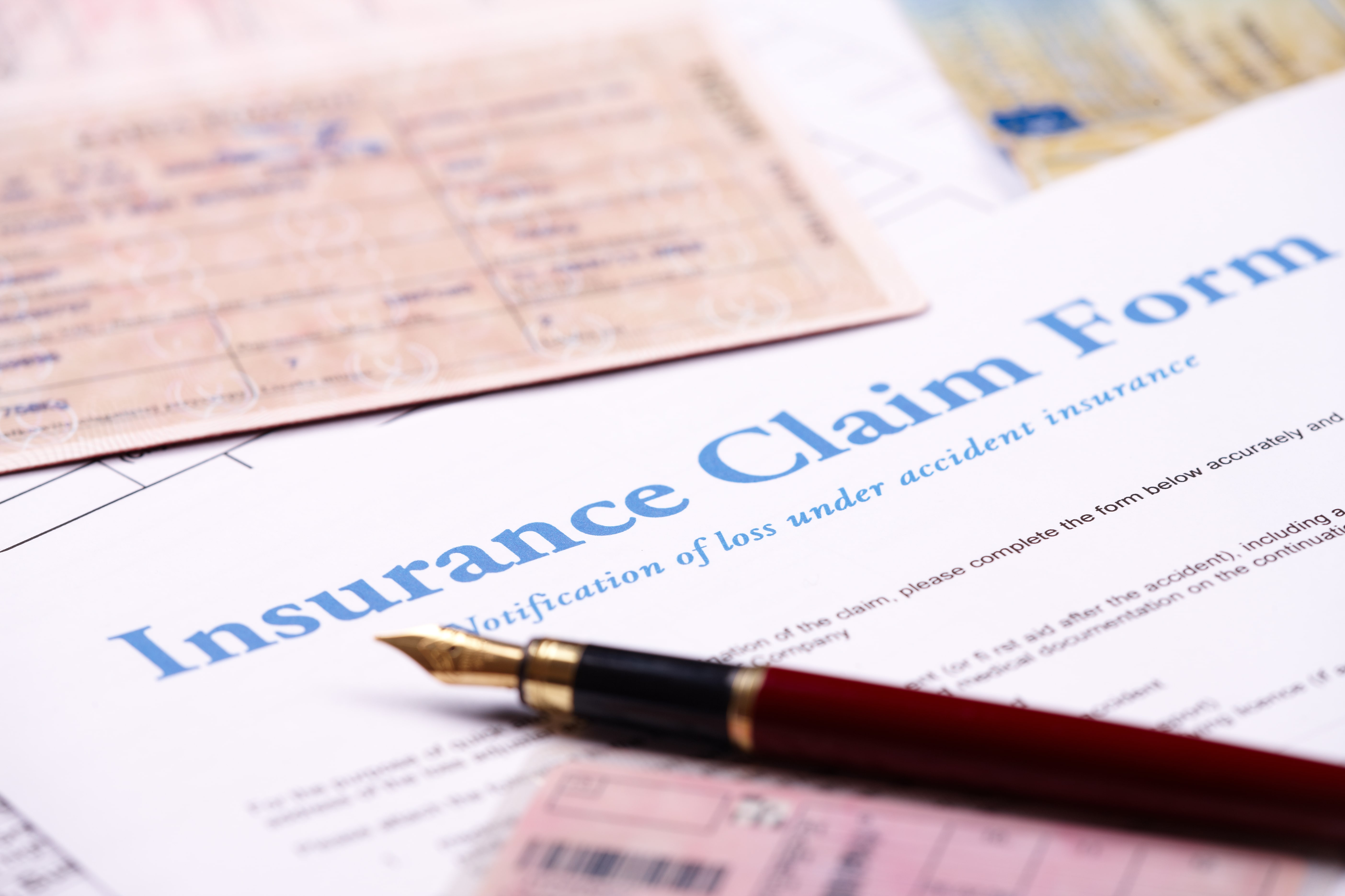 Filing car accident claim form.